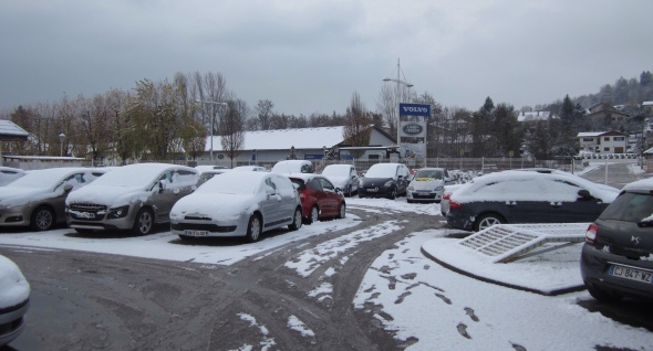 Car Dealership covered in Snow