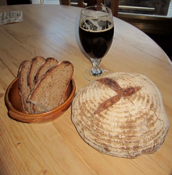 The finished product and a glass of one of the main ingredients (having looked at the photo, I could have even tried to put 4 leaf clover as the cut on the loaf... Maybe next time).