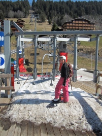 Snow carefully placed just in front of the gate before the chair lift.