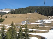 View from the first chair up the hill, with the second station in the sunshine.