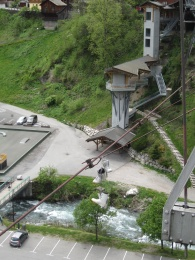 The final farewell to Morzine as the old snowboard boots are dangled off the super M bridge