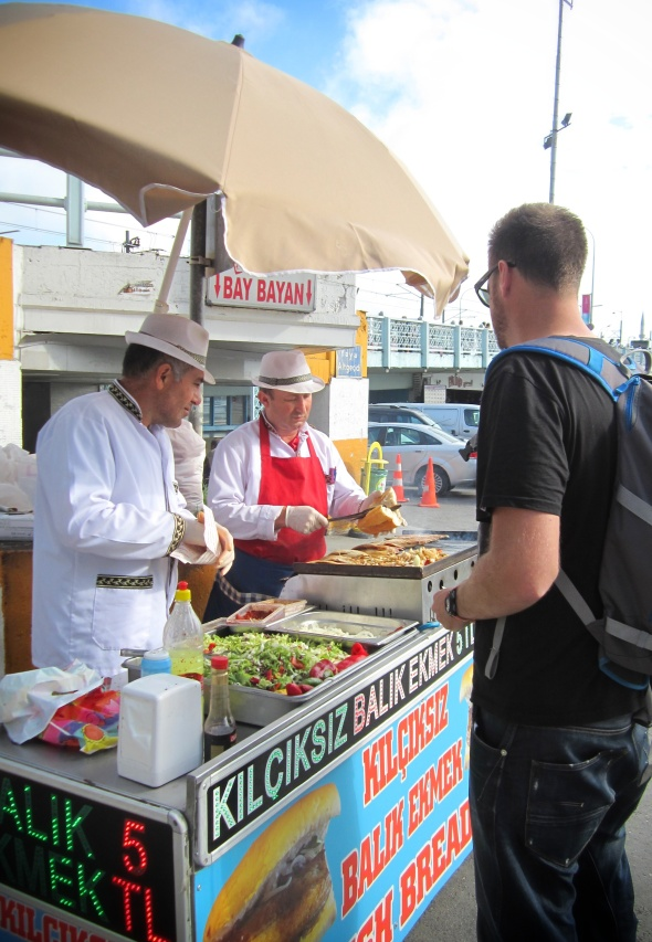 Our happy men selling tasty fish sandwiches