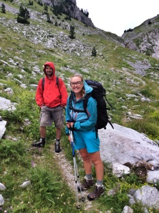 Julie, grinning and bearing it with the pack on day 9 (and an unusual photo of Pavlin smiling :)